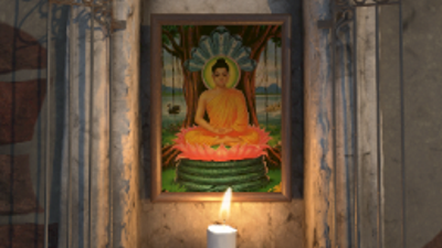 A candle-lit wall shrine with an image of Buddha